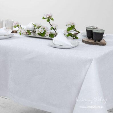 Lniany biały żakardowy obrus w kwiaty. Brzeg gładko wykończony 4 cm.