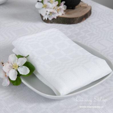Śnieżnobiała lniana serwetka stołowa w kratkę