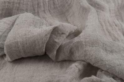 Przeźroczysta prana tkanina niebarwiony len.