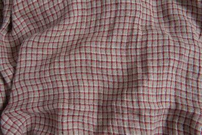 Prana tkanina lniana szara w czerwoną kratkę.
