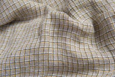 Prana tkanina lniana szara w żółtą kratkę.