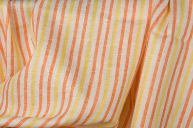 Tkanina lniana w żółte i pomarańczowe paski.