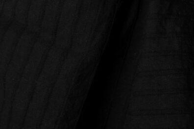 Czarna w paski prana tkanina