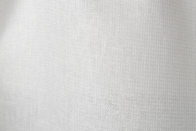 Śnieżnobiała tkanina lniana wzór waflowy.