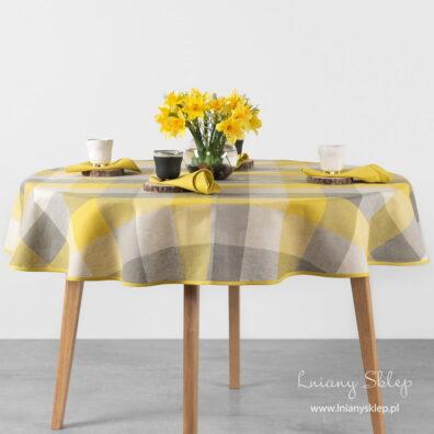 Lniano – bawełniany obrus okrągły (owalny) w żółto – szarą kratkę.