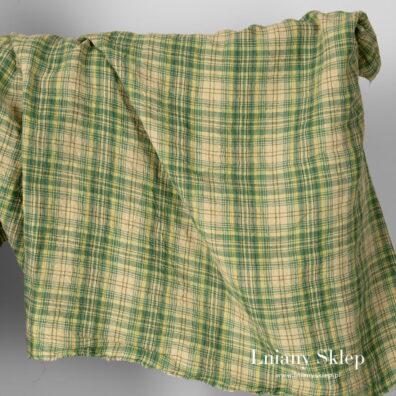 Szeroki prany len w kratkę zieloną.