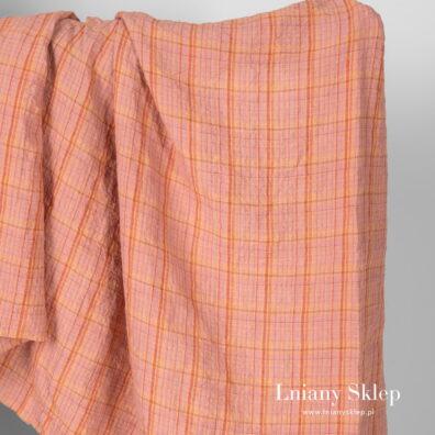 Szeroki prany len w kratkę pomarańczową.