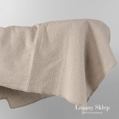 Piaskowa tkanina w wypukły wzorek.