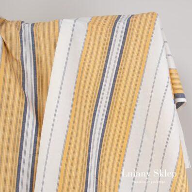 Biała tkanina w żółte i granatowe pasy.