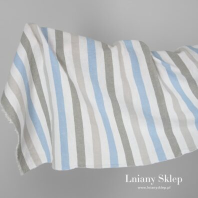 Szeroka prana tkanina w paski szare i niebieskie.