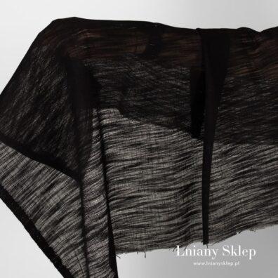 Przeźroczysta tkanina czarna w prążki.
