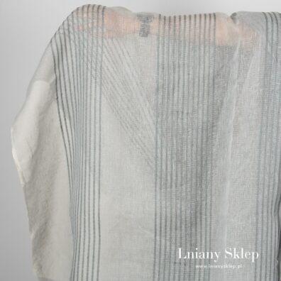 Przeźroczysta szara tkanina w paski z ornamentów.