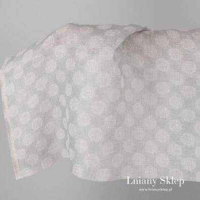Lniana dwustronna tkanina w białe grochy.